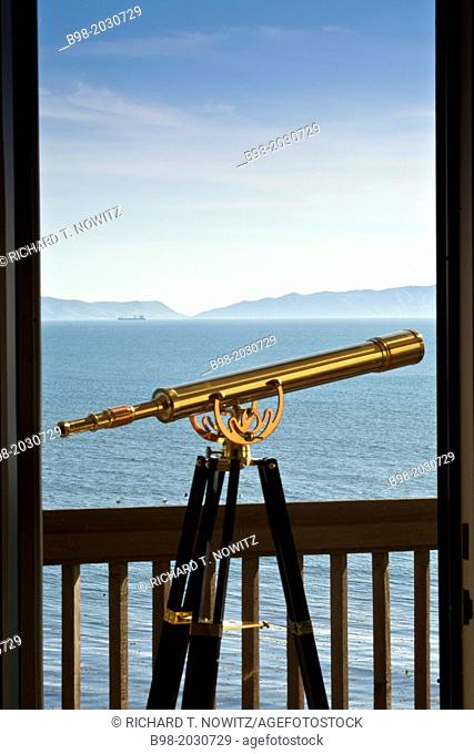 A telescope helps guests look at the Pacific Ocean from the Vanderslip Suite at the Terranea Resort in Palos Verdes, Catolina Island in the background