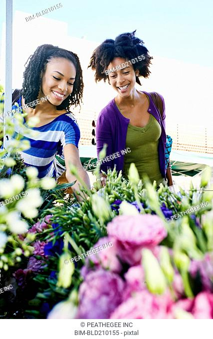 Women shopping together at flower market