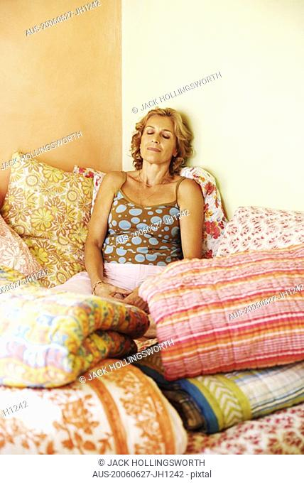 Mature woman resting on the bed