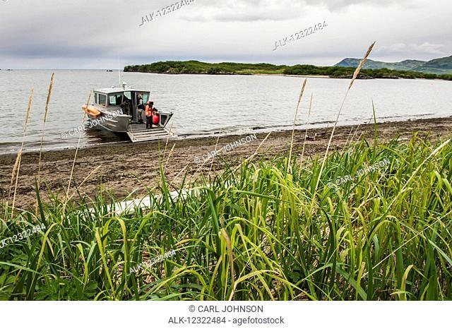 A boat lands at Kukak Bay, Katmai National Park & Preserve, Southwest Alaska, USA