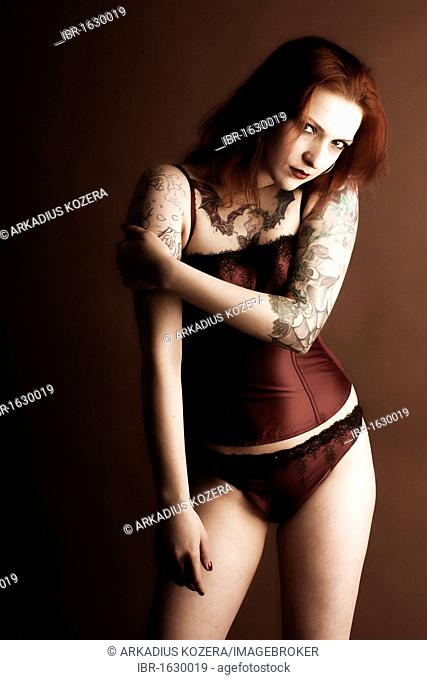Woman, Gothic, red-haired, tattooed