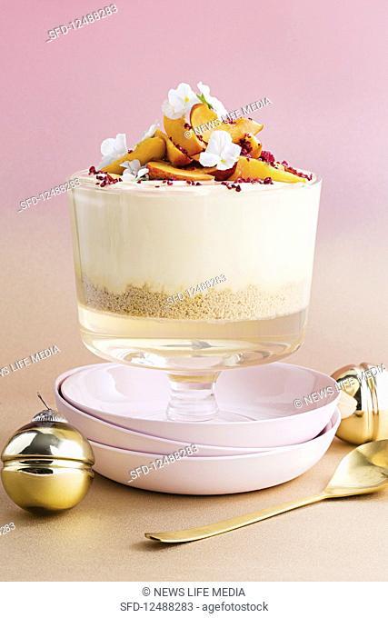 White chocolate and peach trifle