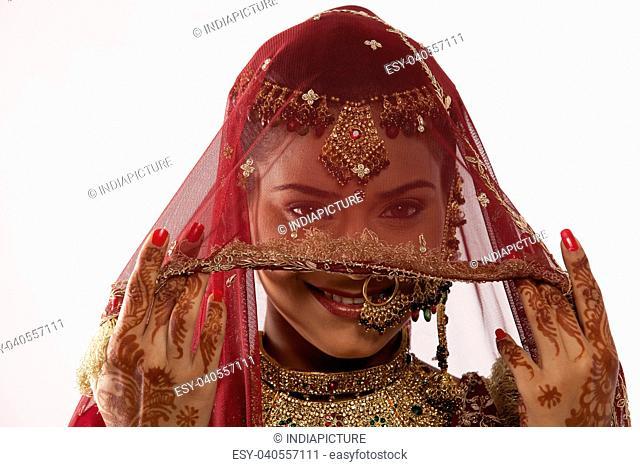 Gujarati brides face hidden behind a veil