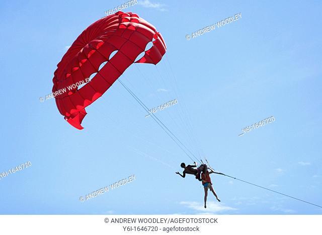 Instructor parasailing with flier Patong Beach after tsunami Phuket island Thailand