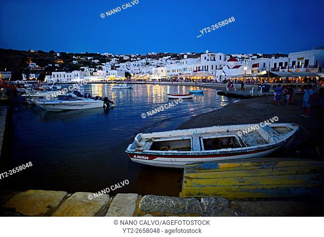 Fishing boats at night in Mykonos town, Greece