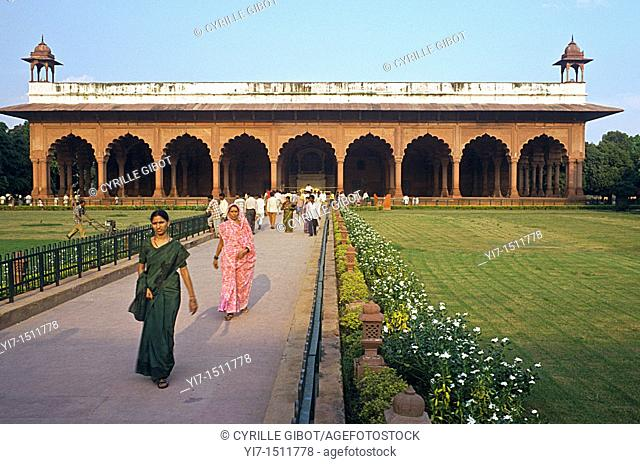 Indian tourists walk to and out of the Diwan-i-Am, or Hall of Public Audience, Red Fort, New Delhi, India