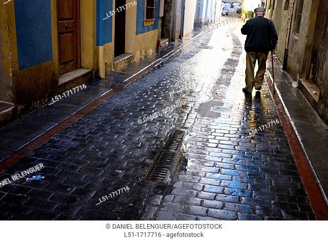 old man walking on an alley, El Carmen, downtown Valencia, Valencia, Spain