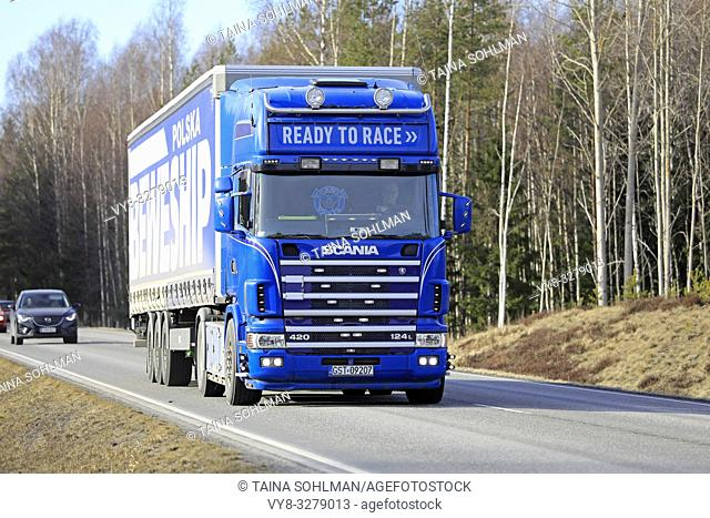 Tenhola, Finland - March 29, 2019: Blue Scania 124L 420 semi trailer Ready to Race transports goods along Highway 52 on a day of spring