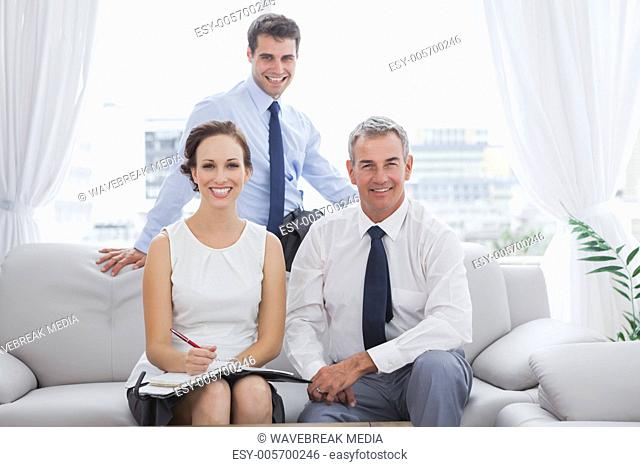 Cheerful partners posing while having a meeting