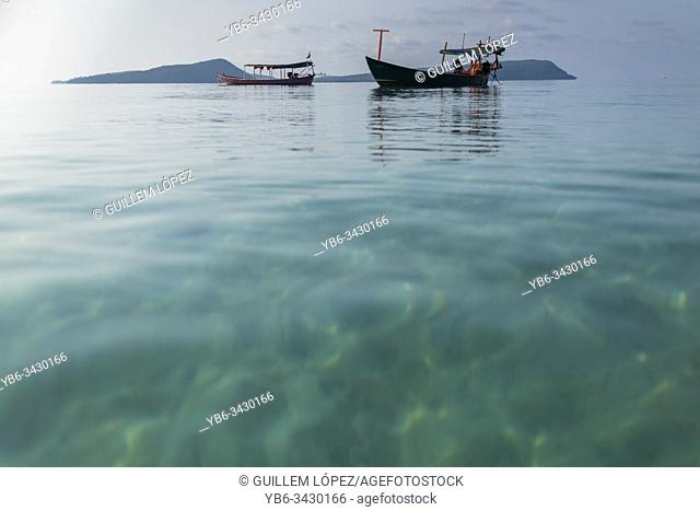 Low perspective view of traditional fishing boats at the Tui beach of Koh Rong Island in Cambodia