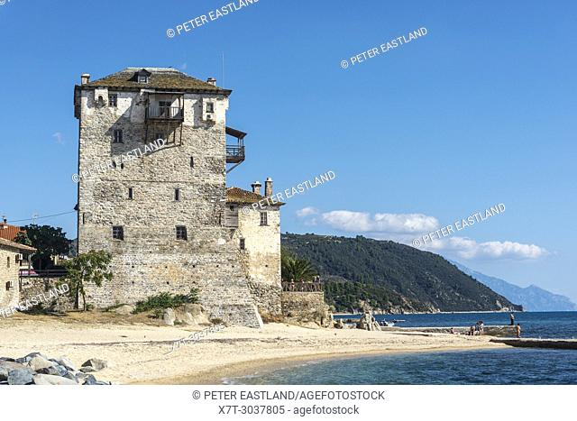 The Prosphorios tower, on the beach at Ouranoupoli with the Athos Peninsula in the background. Chalkidiki, Macedonia, Northern Greece