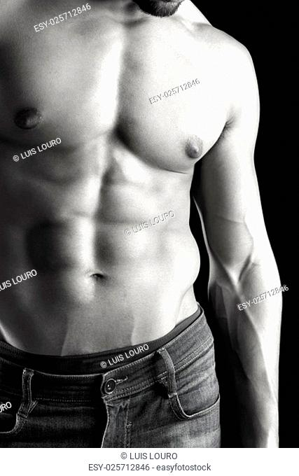 Ma's torso showing great abdominal muscles over a black background