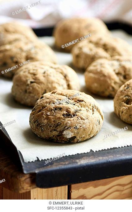 Freshly baked spelt and wild garlic bread rolls