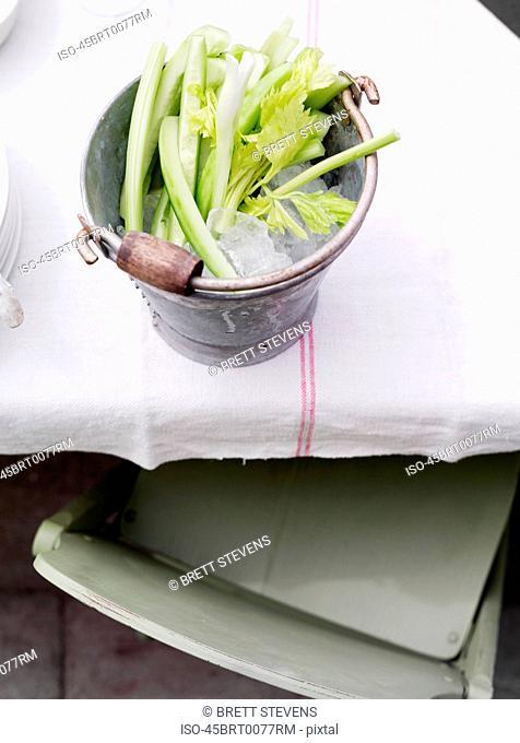 Bucket of celery on ice