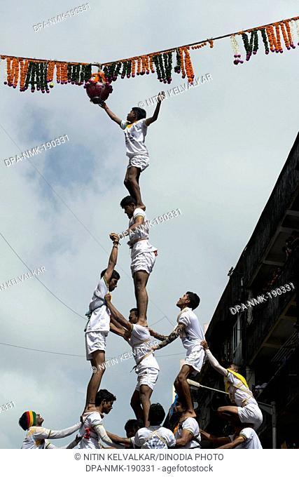 Human pyramid trying to break Dahi Handi Dadar Mumbai Maharashtra India Asia