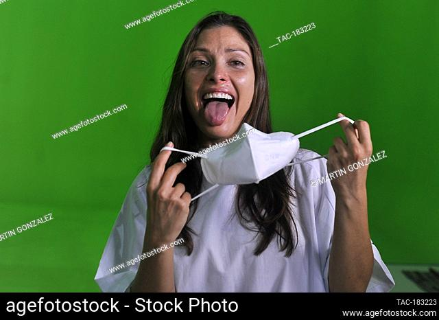 MEXICO CITY, MEXICO - OCTOBER 26: Actress, Carla Hernandez gestures to put on a mask during the slate and press conference of the film (NUDUS)on October 26