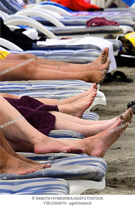 tourists resting at sunbeds, Malta, Europe