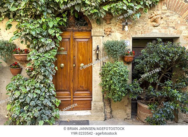 Front door to home in medieval village of Castelmuzio, Tuscany Italy