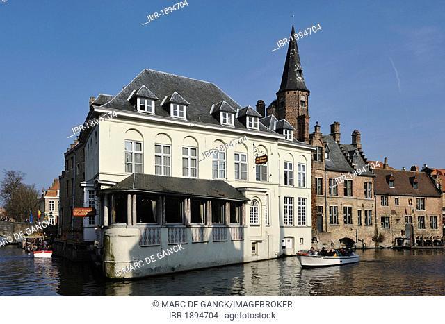 Boats on the Dijver near Hotel Duc de Bourgogne, Bruges, Flanders, Belgium, Europe
