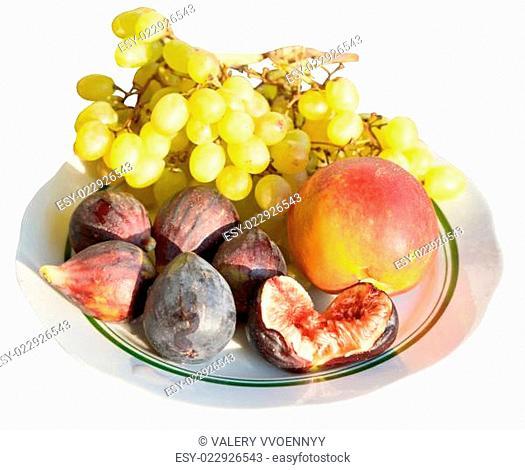 Crimean autumn seasonal fruits on plate isolated