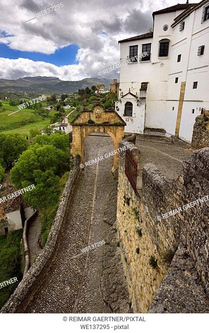 Arch of Felipe V with old stone path entrance to the city of Ronda Spain