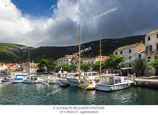 View of Komiza village and its port (Komiza, Vis, Vis Island, Split-Dalmatia county, Dalmatia region, Croatia, Europe)