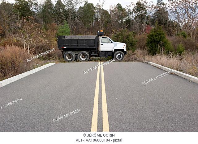 Dump truck parked at dead end on road