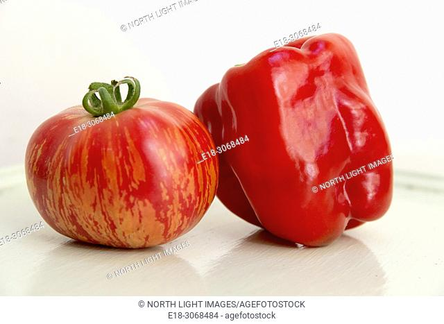 Canada, BC, Delta. Home grown organic heirloom tomato and red pepper