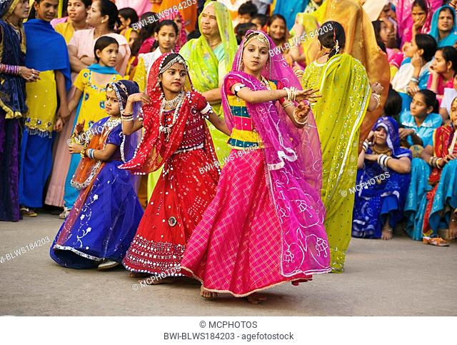 Rajasthani girl dressed in their finest clothing, dancing at the GANGUR FESTIVAL also known as the MEWAR FESTIVAL, India, Rajasthan, Udaipur