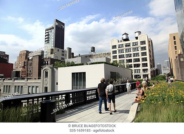 Visitors walking on the High Line Park a linear park built on a section of former elevated New York Central Railroad which runs along the lower west side of...