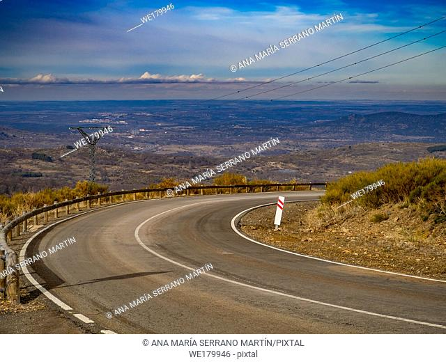 Aerial view of mountain landscape with a road and cloudy sky on a winter day on La Covatilla, Bejar (Salamanca)