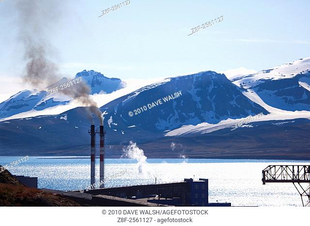 Coal fired power station pouring out smoke in Barentsburg. Barentsburg, a Russian coal mining town in the Arctic Norwegian Archipelego of Svalbard
