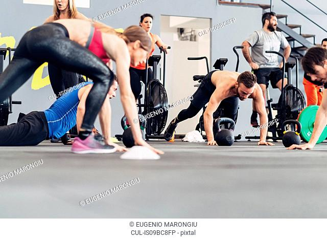 Medium group of people training in gym