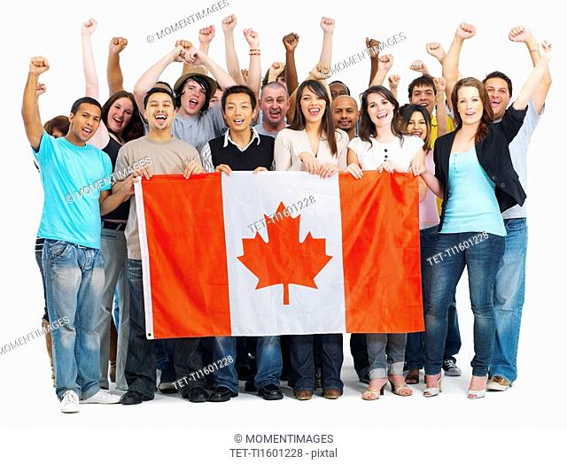 Group of people holding Canadian flag