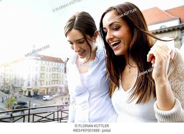 Two happy women on balcony