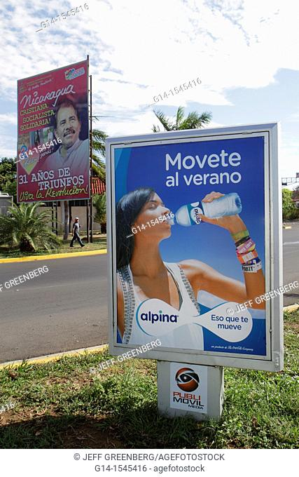 Nicaragua, Managua, Calle Colon, street scene, billboard, ad, marketing, Spanish, language, alpina, brand, bottle water, hydration