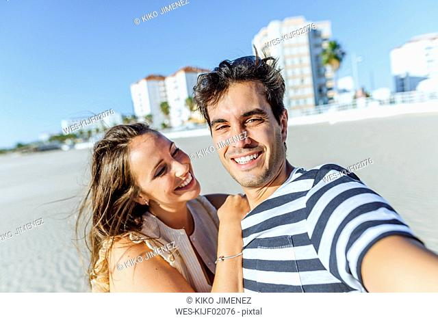 Selfie of a happy young couple on the beach