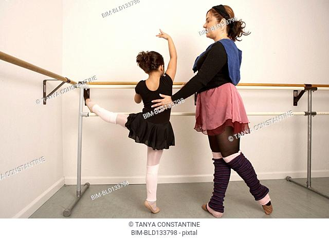 Girl working with ballet teacher