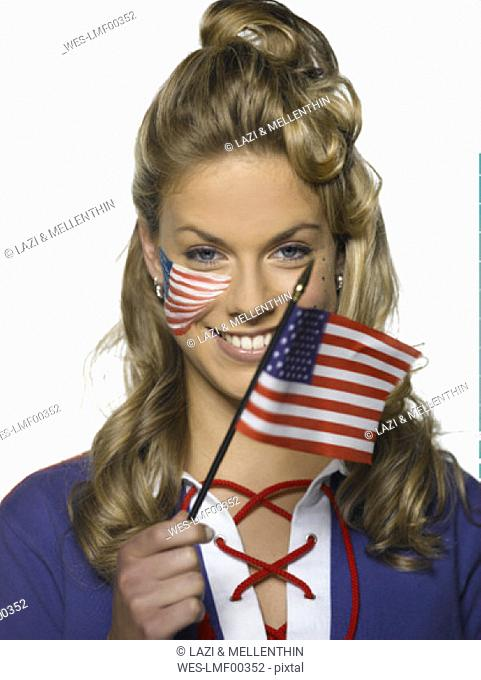 Young woman holding US flag, portrait