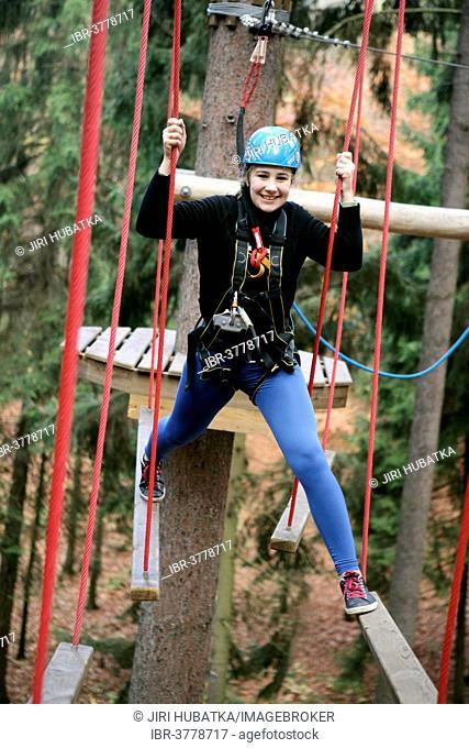 Girl, 13 years, in the climbing park, Svatý Linhart, Karlovy Vary, Region Karlovy Vary, Bohemia, Czech Republic, Europe
