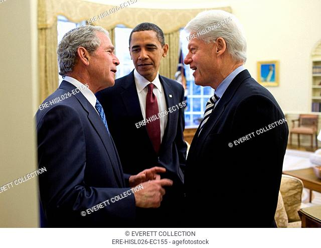 President Obama listens to a conversation between former Presidents Bill Clinton and George W. Bush after recruiting them to help earthquake stricken Haiti