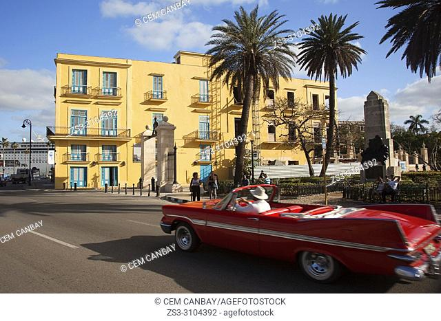 Vintage American car used as taxi in front of the Practico Del Puerto building near the port on Malecon in Old Havana, La Habana, Cuba, Central America
