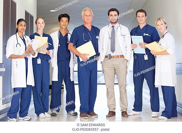 Portrait of confident doctors and nurses in hospital corridor