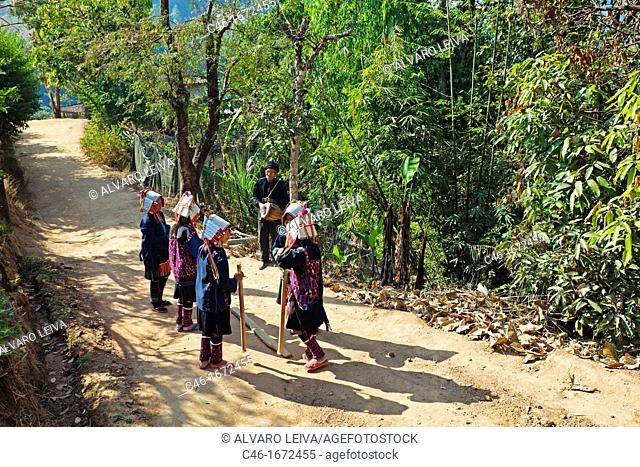 Women dancing, Akha hill tribe, Lhosa village, Chiang Rai Province, Thailand