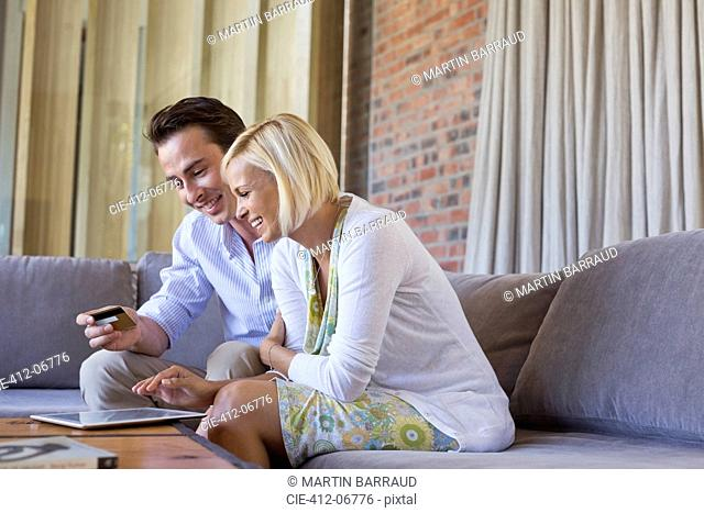 Couple shopping online with tablet computer