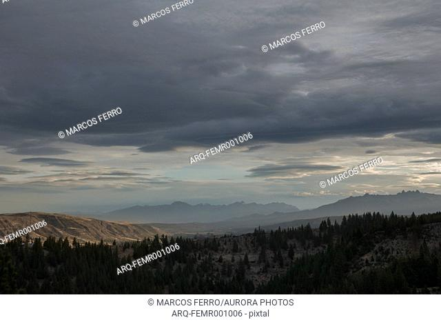 Cloudy sky over mountain valley at dusk, Esquel, Chubut, Argentina