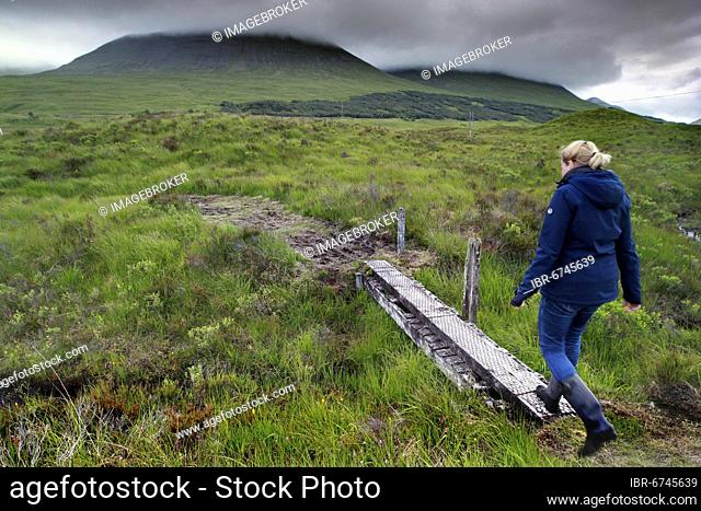 Loch Tulla, lake, woman in wellies, Glen Coe valley, highlands, highlands, Scotland, Great Britain