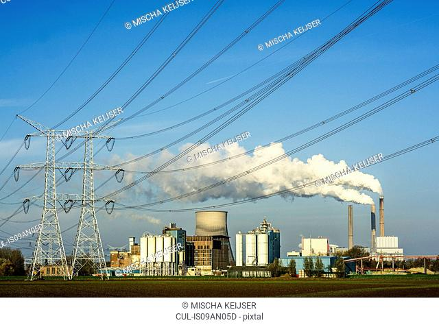 View of coal fired power station and electrical towers