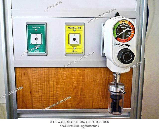 Vacuum Regulator for both intermittent and continuous suction. Also shown are oxygen and medical air connections in a hospital room
