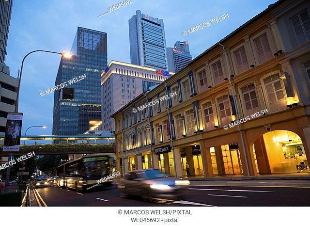 Traffic in Singapore with buildings in background